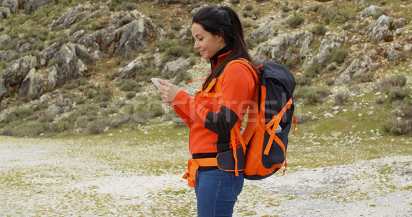 Active fit young hiker checking her route Stock photo © dash