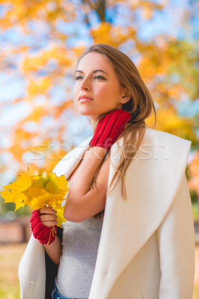 Elegant young woman standing daydreaming Stock photo © dash