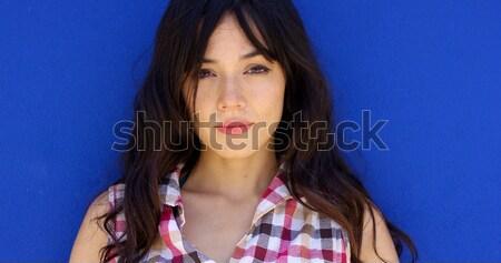 Stock photo: Attractive young brunette wearing halter top