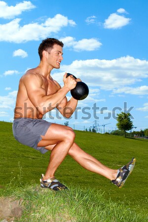 Sporty man practicing with weights Stock photo © dash