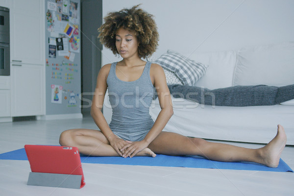 Young woman training at home with tablet Stock photo © dash