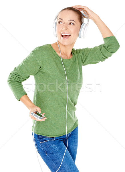 Blissful woman dancing and listening to music Stock photo © dash