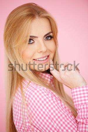 Happy young blond woman with a beaming smile Stock photo © dash