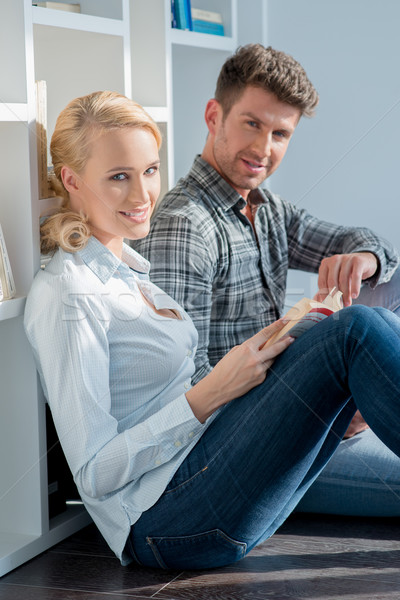 Young Couple Sitting on Floor at Mini Library Stock photo © dash
