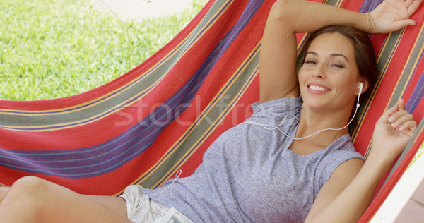 Blissful young woman relaxing listening to music Stock photo © dash