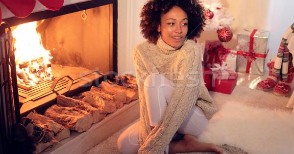 женщину сидящий камин праздник Сток-фото © dash