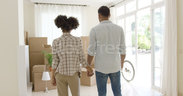 Loving young couple saying goodbye to their home Stock photo © dash