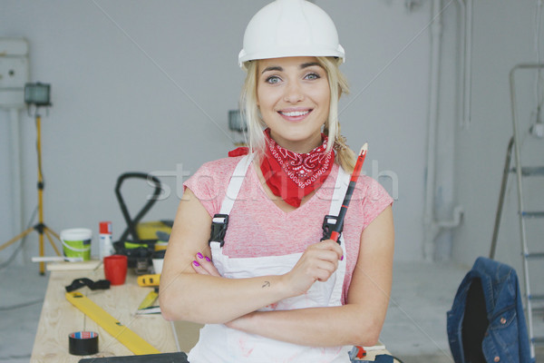 Female construction worker standing at workbench  Stock photo © dash