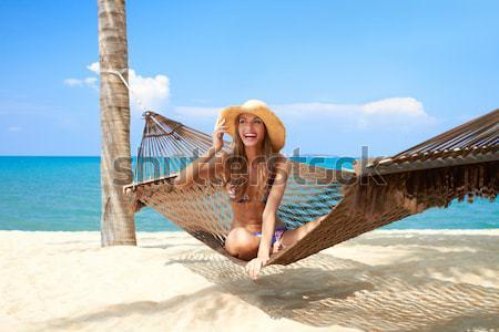 Woman enjoying the serenity of a tropical beach Stock photo © dash