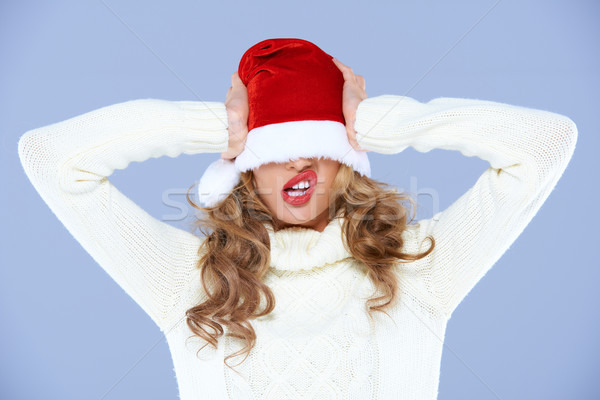 Young woman in an oversized Santa hat Stock photo © dash