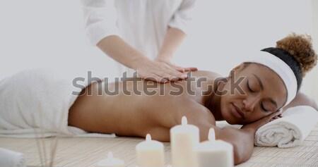 Woman Getting Hot Stone Massage Stock photo © dash
