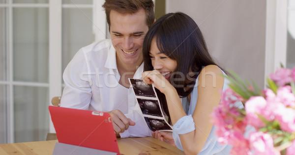 Boldog pár mutat el ultrahang képek Stock fotó © dash