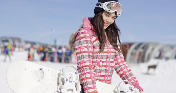 Young smiling woman with ski boots Stock photo © dash
