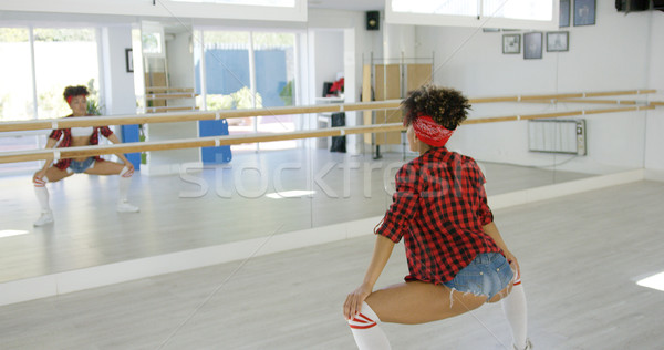 Female dancer practices her moves in studio Stock photo © dash