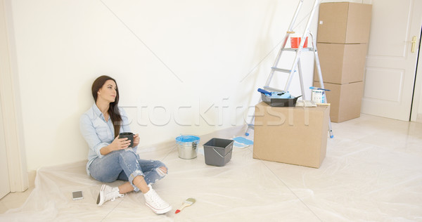 Tired young woman relaxing during renovations Stock photo © dash