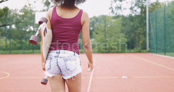 Girl with skateboard on sports ground Stock photo © dash