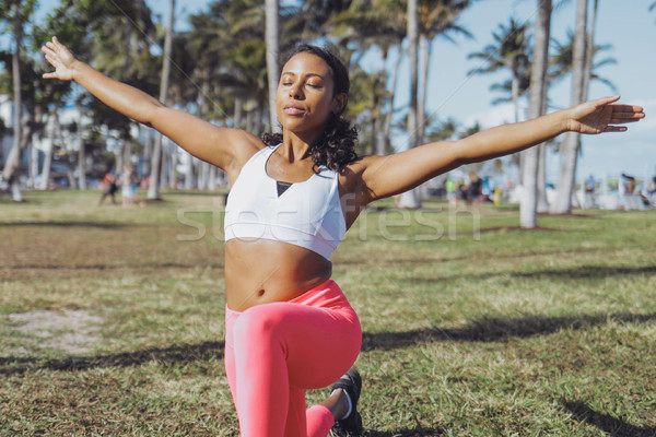 Relaxed black woman doing exercise in park Stock photo © dash