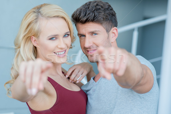 улыбаясь привлекательный пару указывая камеры Постоянный Сток-фото © dash