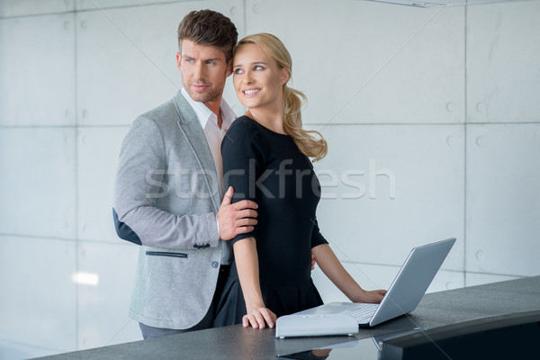 Couple Fashion Shoot at Long Table with Laptop Stock photo © dash