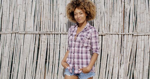 Adorable mujer posando pared jóvenes Foto stock © dash