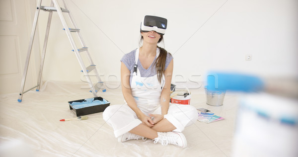 Smiling young woman wearing a VR headset Stock photo © dash