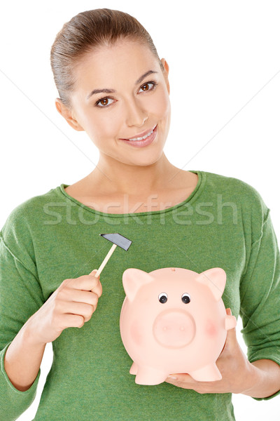 Woman contemplating opening her piggy bank Stock photo © dash