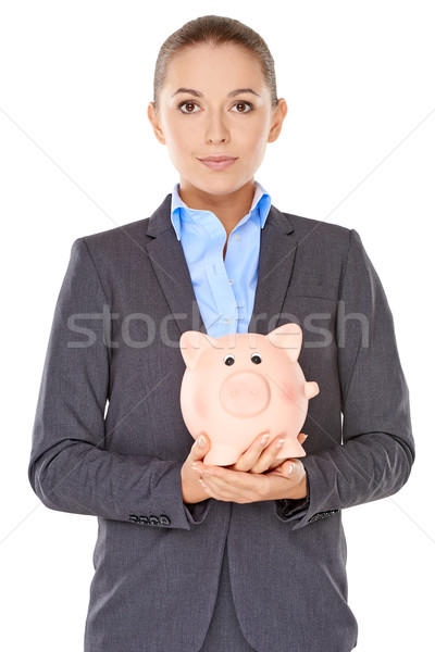 Businesswoman holding a piggy bank Stock photo © dash