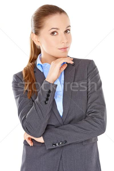 Sceptique femme d'affaires permanent regarder caméra bras Photo stock © dash