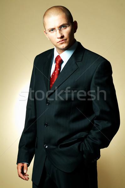 Işadamı siyah takım elbise kırmızı kravat iş Stok fotoğraf © dash