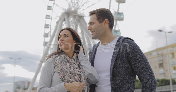 Young couple standing in front of a ferris wheel Stock photo © dash