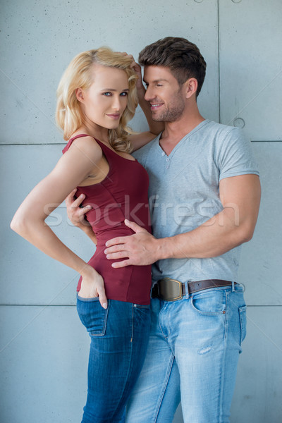 Sexy Couple with Arms Around Each Other Stock photo © dash