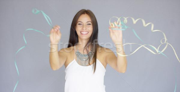 Vivacious woman at a fun New Year party Stock photo © dash