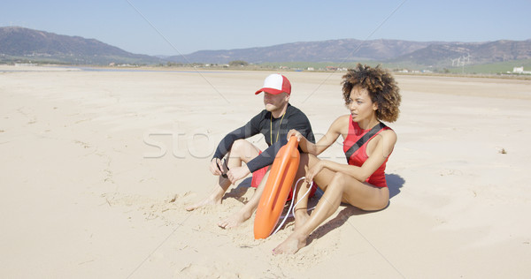 Female and male lifeguards patrolling beach Stock photo © dash