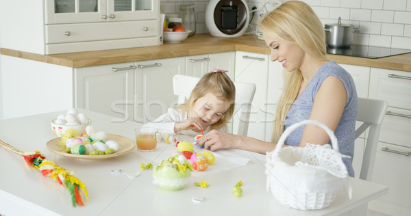 Loving family coloring Easter eggs Stock photo © dash