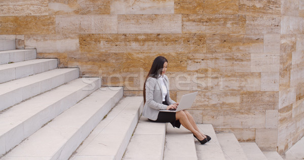 Low angle view of woman using laptop outdoors Stock photo © dash