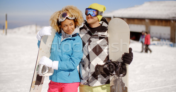 Affectionate young couple posing with snowboards Stock photo © dash