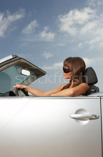 Menina carro mulher cabriolé nuvens mar Foto stock © dash