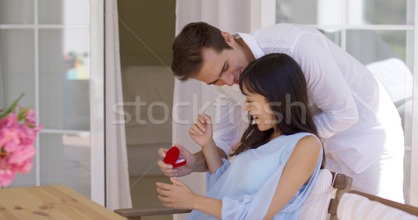 Romantic young man proposing to his girlfriend Stock photo © dash