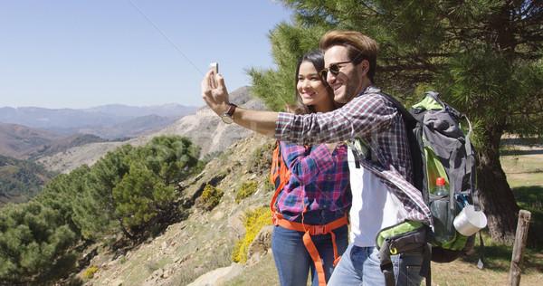 People taking selfie while hiking Stock photo © dash