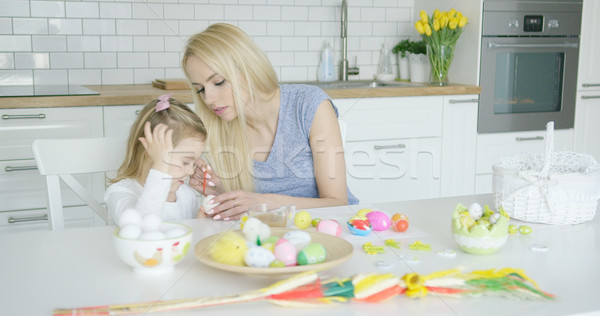 Mother and daughter coloring eggs Stock photo © dash
