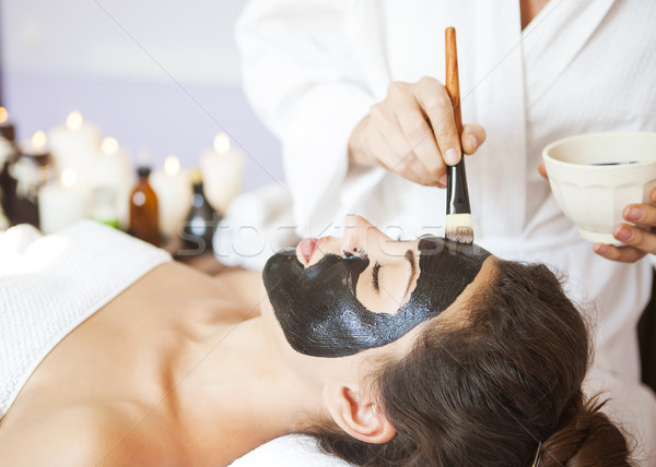 Stock photo: Young beautiful woman in a mask for the face of the therapeutic