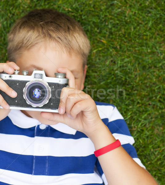 Stock photo: Happy smiling little boy with retro vintage camera