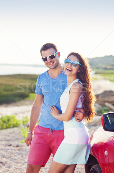 Portrait of a smiling couple with at beach by the car Stock photo © dashapetrenko