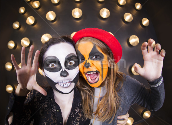 Woman and girl with painted faces. Halloween theme Stock photo © dashapetrenko