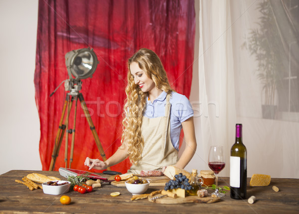 Happy blond woman cooking at the kitchen Stock photo © dashapetrenko
