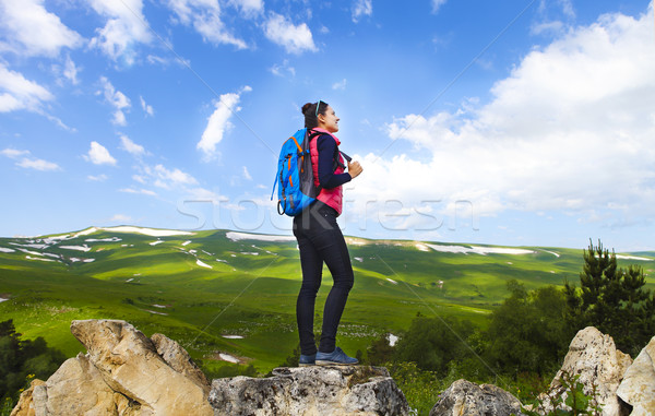 Hiker with backpack on top of mountain and enjoying valley view Stock photo © dashapetrenko