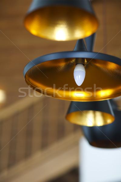 Preto lâmpada teto madeira parede Foto stock © dashapetrenko