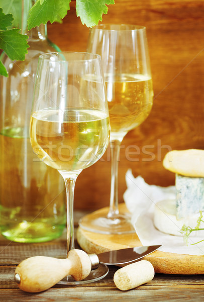 Still life with glasses of white wine and chesse Stock photo © dashapetrenko