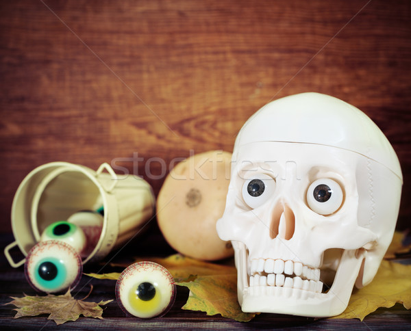 Creepy skull, halloween sweets and pumpkins Stock photo © dashapetrenko