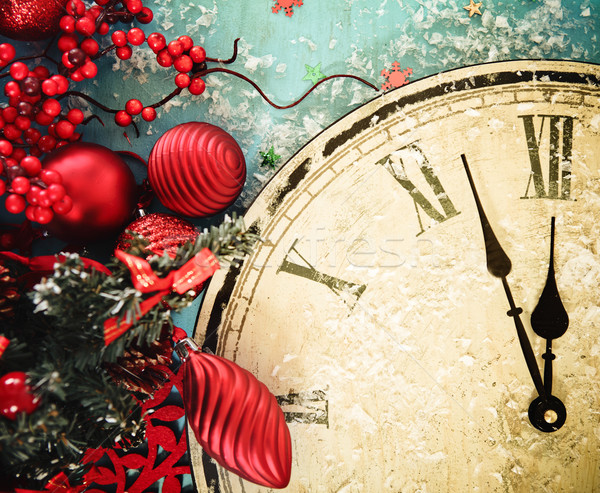 Christmas clock and fir branches covered with snow Stock photo © dashapetrenko